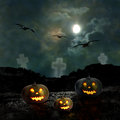Halloween pumpkins in the yard of an old house at night bright moonlight Stock Photos