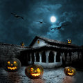 Halloween pumpkins in the yard of an old house at night bright moonlight Royalty Free Stock Photo