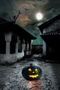 Halloween pumpkins in the yard of an old house at night bright moonlight Stock Images