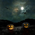 Halloween pumpkins in the yard of an old house at night bright moonlight Royalty Free Stock Images