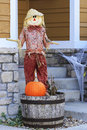 Halloween scarecrow with orange pumpkin Stock Photos