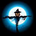 Halloween scarecrow a silhouetted by the moon Stock Photos