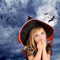 Halloween scared kid girl on dark moon sky Royalty Free Stock Photos