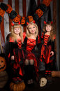 Halloween scene with three attractive witches Royalty Free Stock Photo