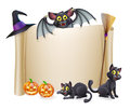 Halloween scroll sign and bat a with a character above the banner pumpkins witch s cats hat broomstick Royalty Free Stock Photo