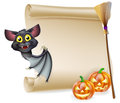 Halloween scroll with space an illustration of a for your message and witches cats and broomstick and cartoon bat Royalty Free Stock Images