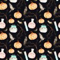 This halloween seamless pattern on a black background included magic cauldron,potion bottles,bats,ravens,branches and pumpkin.