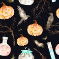 This halloween seamless pattern on a black background included magic cauldron,potion bottles,bats,ravens,branches and crazy pumpki