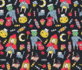 Halloween seamless pattern. Kids and cats in costumes with sweets on the polka dot background. Vector illustration.