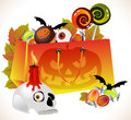 Halloween shopping bag with scary face and sweets Royalty Free Stock Image