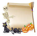 Halloween skeleton scroll banner or sign with orange carved pumpkins and black witch s cats witch s broom stick and cartoon Royalty Free Stock Images