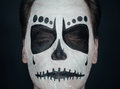 Halloween skull man portrait of young with closed eyes and sugar makeup face art Stock Photography