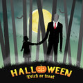 Halloween slender tall man with girl in forest Royalty Free Stock Photo