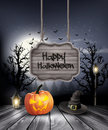 Halloween spooky background with wooden sign.