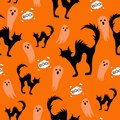 Halloween spooky cats and ghost seamless pattern on orange background with cloud boo. Funny cat halloween pattern Royalty Free Stock Photo