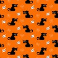 Halloween spooky cats seamless pattern on orange background and cloud boo. Funny cat halloween pattern background. Royalty Free Stock Photo