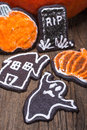 Halloween sugar cookies assorted chocolate in the shapes of ghost graves pumpkins and haunted houses Stock Photos