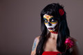 Halloween sugar skull girl with red rose day of the dead theme Stock Images