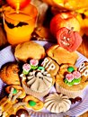 Halloween table with trick or treat and cake Stock Photography