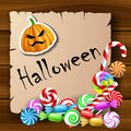 Halloween text frame with candies and pumpkin sticker on wood background eps Stock Photo
