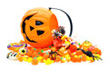 Halloween treats candy spilling from a jack o lantern holder Stock Image