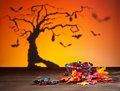 Halloween tree bats and sweets golden leafs Stock Photo