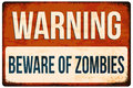 Halloween warning sign. Beware of zombies. Vector illustration, eps10. Royalty Free Stock Photo