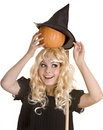 Halloween witch in black hat  with pumpkin . Stock Photos