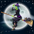 Halloween witch e a happy cartoon flying on her broom stick with her black cat and a full moon in the background Stock Images