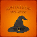 Halloween witch hat on orange background