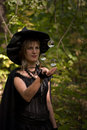 Halloween witch with levitating crystal balls in the forest focus on Stock Photo