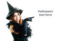 Halloween witch pretty young happy woman smiling and dressed as a fairy or for party show point finger to copyspace Stock Photo
