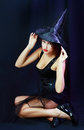 Halloween woman charming witch over dark background Royalty Free Stock Photography