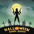Halloween zombie hunter with handgun in graveyard