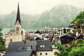 Hallstatt, Austria village, church and Alpine foggy lake, roofto Royalty Free Stock Photo