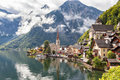 Hallstatt village in austrian alps with clouds and mountain lake Stock Photo