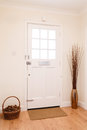 Hallway and front door contemporary in a house with a white Royalty Free Stock Photos