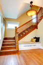 Hallway interior. Old staircase with bench Royalty Free Stock Photo