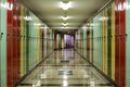 Hallway lined with lockers tunnel like multi colored Stock Photography