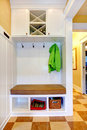 Hallway storage cabinet white with hangers bench three units under the bench and three section wine on the top Royalty Free Stock Photography