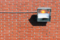 Halogen lamp on wall outdoors Royalty Free Stock Photos
