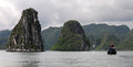 Halong bay vietnam cruise tourist boats at famous resort in city is made of limestone islands Stock Image