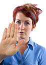 Halt young redhead woman holding out her palm Royalty Free Stock Photo