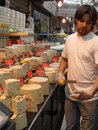 Halva seller in mahane yehuda market talking about his products to a client jerusalem Stock Images