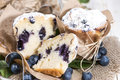 Halved blueberry muffin with fresh fruits Stock Photo
