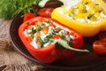 Halved fresh peppers filled with curd and dill close-up Royalty Free Stock Photo