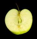Halved green apple in black back Stock Photo