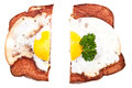 Halved meat loaf with fried egg Stock Photo