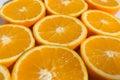 Halved oranges , sliced orange fruits closeup Royalty Free Stock Photo