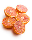 Halves of red oranges on white background Royalty Free Stock Images